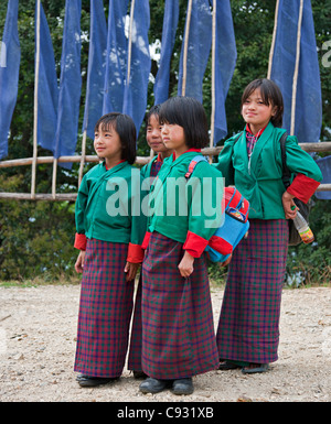 Schoolgirls on their way back from school near Mongar, a small hilltop town in East Bhutan. - Stock Photo