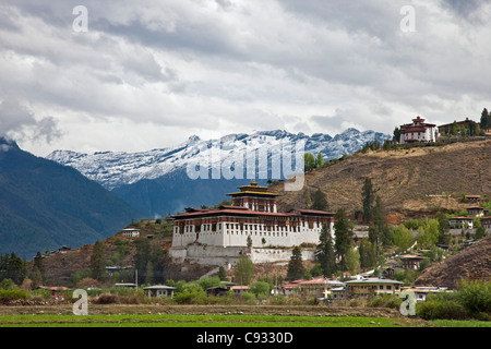 The very impressive 16th century Paro Dzong and its round watchtower, now a national museum. - Stock Photo