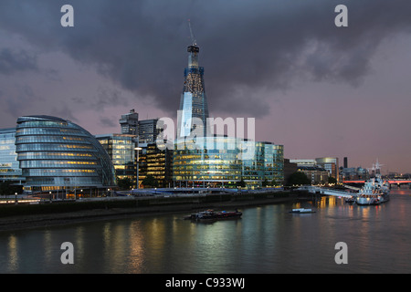 A storm is building up over the new tower on London's southbank, the Shard. In the foreground the city hall from - Stock Photo