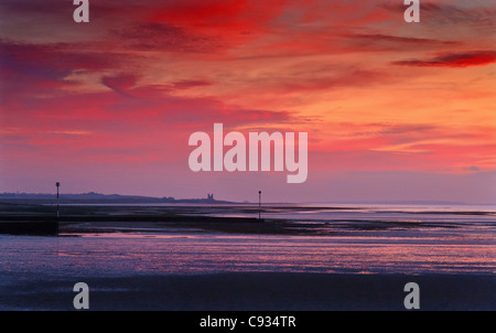 Red sky over Reculver Towers,Kent,England, at sunset. - Stock Photo