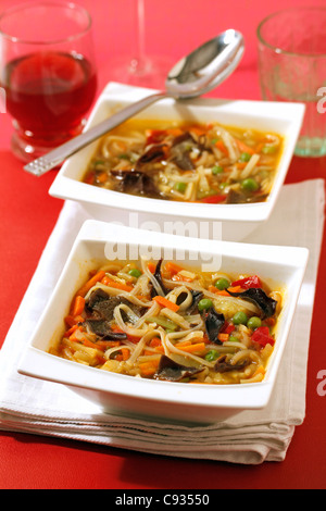 Chinese soup with vegetables and mushrooms. Recipe available. - Stock Photo