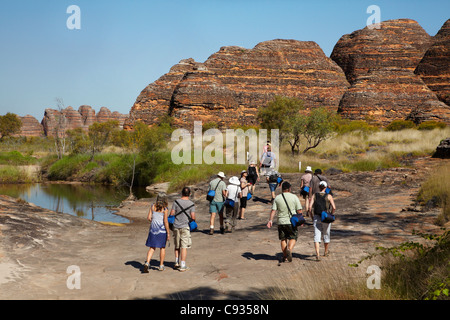 Tourists on track to Cathedral Gorge, Bungle Bungles, Purnululu National Park, Kimberley Region, Western Australia, - Stock Photo