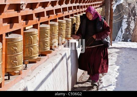 India, Ladakh, Alchi. Turning the prayer wheels at Alchi. - Stock Photo