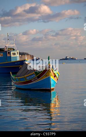 Malta, Europe; Colourful traditional Maltese boats known locally as 'luzzu' in Marsaxlokk - Stock Photo
