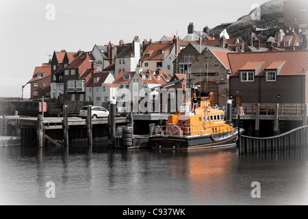 Whitby by the sea, with the boats at the docks and dockyard showing the beautiful views with the lifeboat in the - Stock Photo