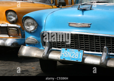 Vintage cars Chevrolet parked next to the National Capitol at Paseo del Prado in Havana, Cuba. - Stock Photo