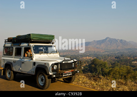 Malawi, Zomba.  Tourists in a self-drive landrover look out at the view over the town of Zomba. (MR) - Stock Photo