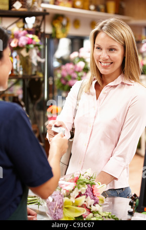 Woman shopping in florist - Stock Photo