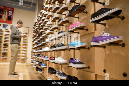 Man Looking At Shoes In Store Stock Photo, Royalty Free Image ...