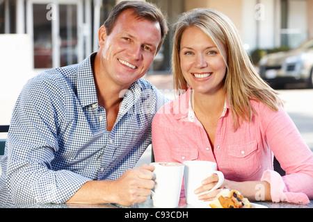 Couple sitting at sidewalk café - Stock Photo