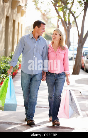 Couple carrying shopping - Stock Photo