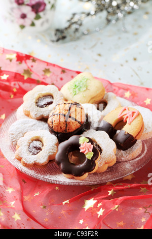 Variety of Christmas cookies on a festive tablecloth - Stock Photo