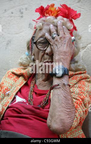 Eccentric old Cuban woman in the historical centre of Havana, Cuba. - Stock Photo