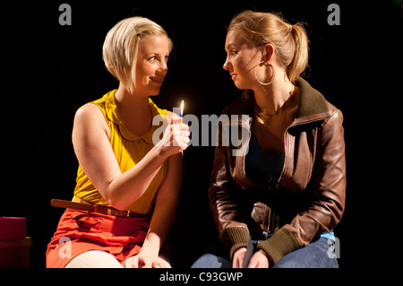 Two women actors performing in Gary Owen's dark comedy 'Cancer Time' at Aberystwyth Arts Centre wales uk - Stock Photo
