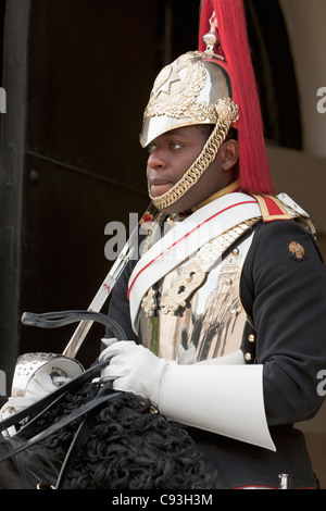 A member of the Queen's Household Cavalry guarding the Horse Guard Building, London, England - Stock Photo