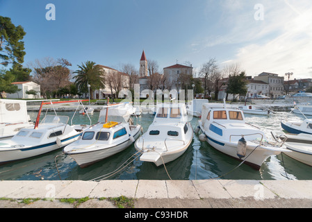 A line of pleasure boats outside Trogir, Croatia. Trogir is a historic port town in Dalmatia, on Croatia's Adriatic - Stock Photo