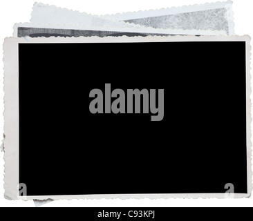 Blank photo frame on a stack of old photos. Clipping path included for eassy issolation - Stock Photo