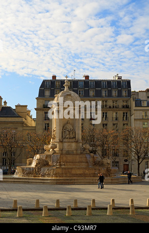 St Sulpice square and fountain, Paris, France. The fountain was built in 1844-48, designed by the architect Joachim - Stock Photo