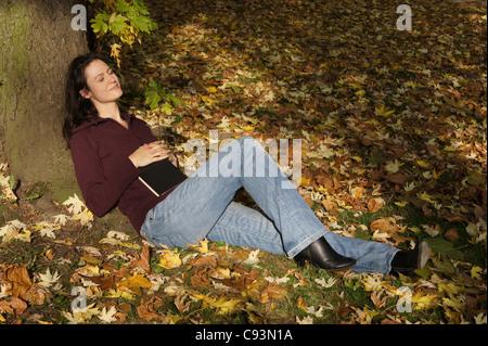woman relaxing in autumn scene