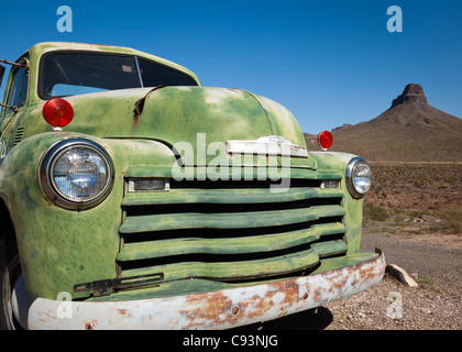 The front of an old, green, rusting and abandoned Chevrolet truck on a sunny day along Route 66, Arizona, USA - Stock Photo