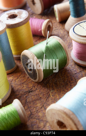 Cotton reels on table top - Stock Photo