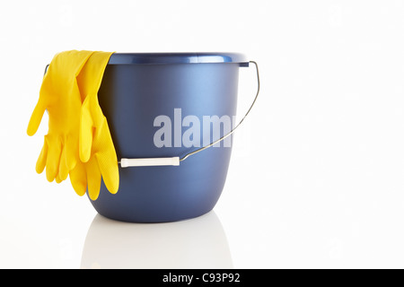 Bucket and rubber gloves - Stock Photo