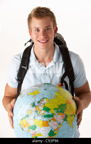 Young traveller with globe - Stock Photo