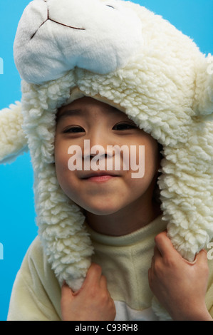 Boy in sheep clothing, portrait - Stock Photo