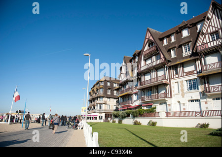 The 'Planches', beach boardwalk, of Trouville-sur-Mer in Normandy is bordered by Norman-style holiday villas, hotels, - Stock Photo