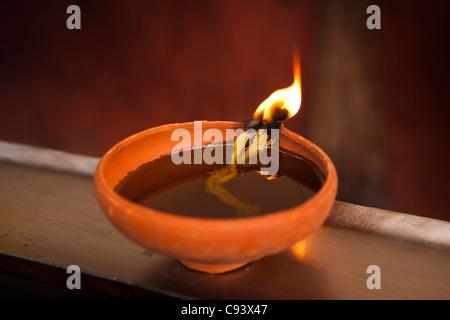 India, Assam, Guwahati, Kamakhya Shakti Peeth mother goddess Temple, oil lamp burning