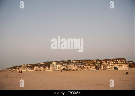 Sandy beach of the seaside resort Trouville-sur-Mer at the estuary of the Touques river in Normandy, France - Stock Photo