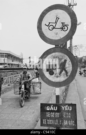 Asia, Vietnam, Ninh Binh. Road traffic and road signs. - Stock Photo