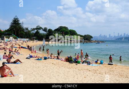 Sunbathers enjoying sunny day  in November at Camp Cove, Sydney, Australia - Stock Photo