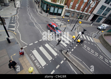 Zebra crossing or pedestrian crossing Central London - Stock Photo
