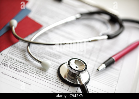 Medical records and stethoscope - Stock Photo