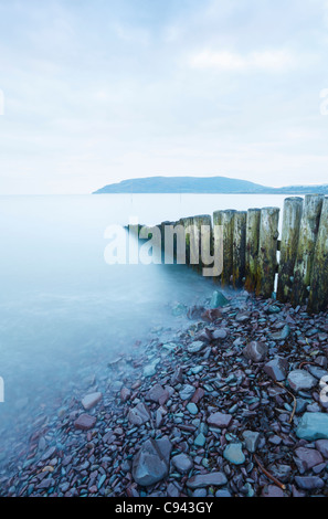 Groyne at the entrance to Porlock Weir Harbour with Bossington Hill in the Distance. Somerset. England. UK. - Stock Photo