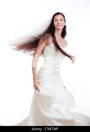 portrait of a bride with long dark hair in wedding dress - isolated on white - Stock Photo