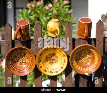 Traditional folk pottery on display. - Stock Photo