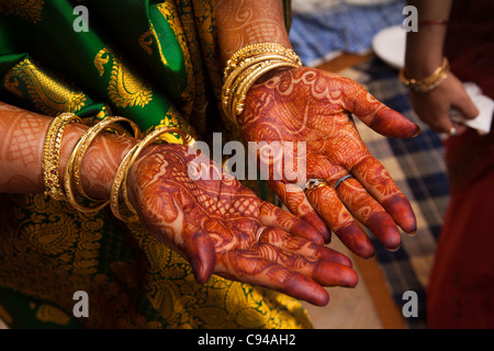 India, Assam, Guwahati, weddings mehndi, traditional henna decorative patterns on hands of bride - Stock Photo