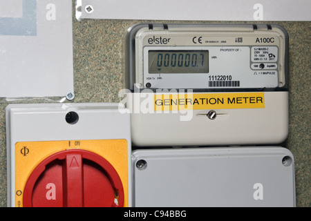 New domestic Generation meter recording number of units of electricity generated from solar panels on Feed-in Tariff - Stock Photo