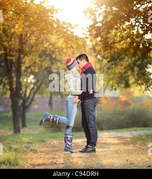 A view of a loving couple kissing in the park - Stock Photo