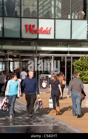 Shoppers at entrance to Westfield shopping centre, Stratford, London UK - Stock Photo