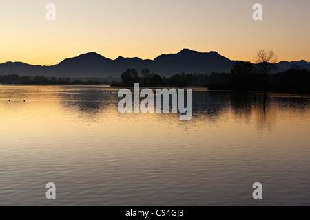 Chiemsee at sunrise, Chiemgau Upper Bavaria Germany - Stock Photo