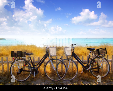bicycles couple parked in Formentera beach of Illetes - Stock Photo