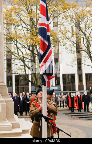 Soldier lowers the Union Jack to half mast during the Remembrance Sunday wreath laying ceremony, Belfast 13/11/2011 - Stock Photo