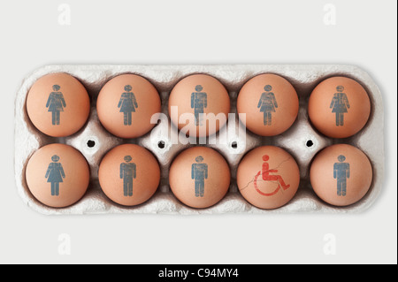 Box of eggs. Male and female symbols on nine of them and one cracked egg with a disabled symbol on it - Stock Photo