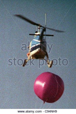 helicopter barrage balloon paparazzi photographer California USA - Stock Photo