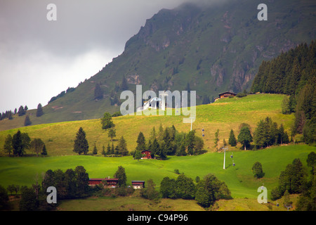 Alps mountains in Tirol Austria.Summertime with operating ski lifts. - Stock Photo