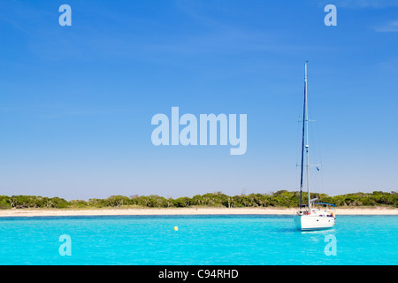 Luxury sailboat in turquoise beach of Formentera Illetes - Stock Photo