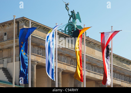 European and German flag at Brandenburg Gate in Berlin; Brandenburger Tor in Berlin - Stock Photo